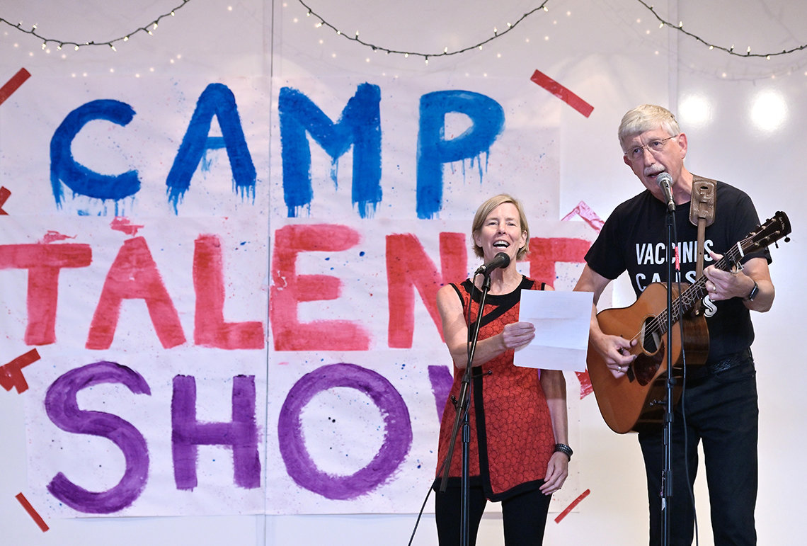 Dr. Collins plays guitar and sings with his wife at talent show.