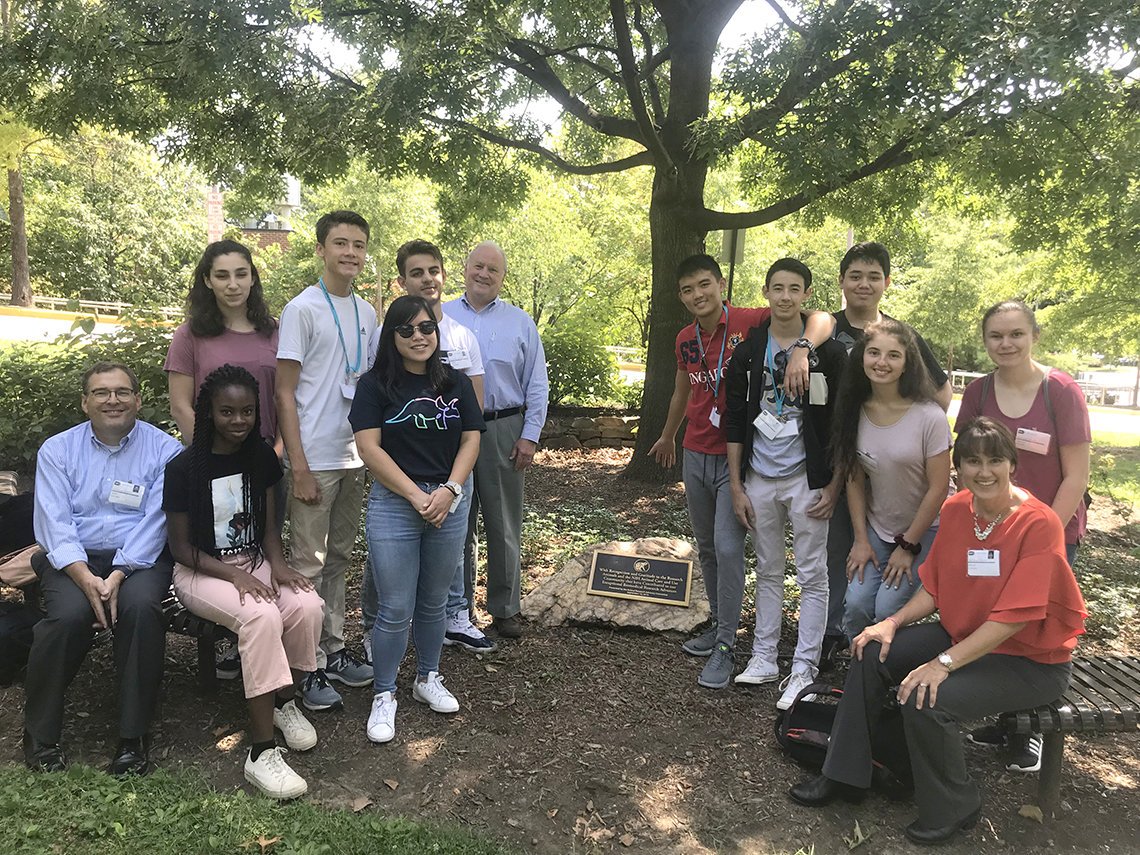 Young science writers gather outdoors at NIH.