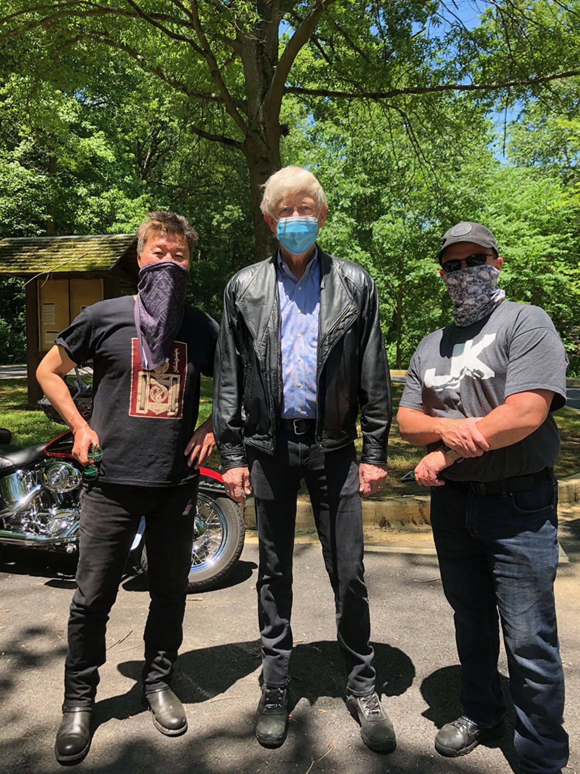 Three NIH'ers get ready to ride motorcycles.