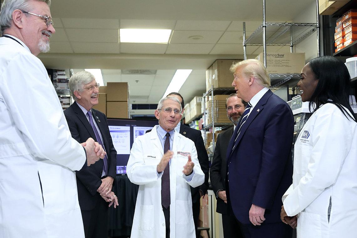 Graham, Collins, Fauci, Azar, Trump, and Corbett in a lab