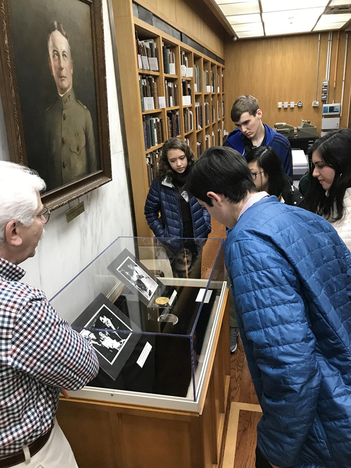 Kids view Nobel Prize medal.
