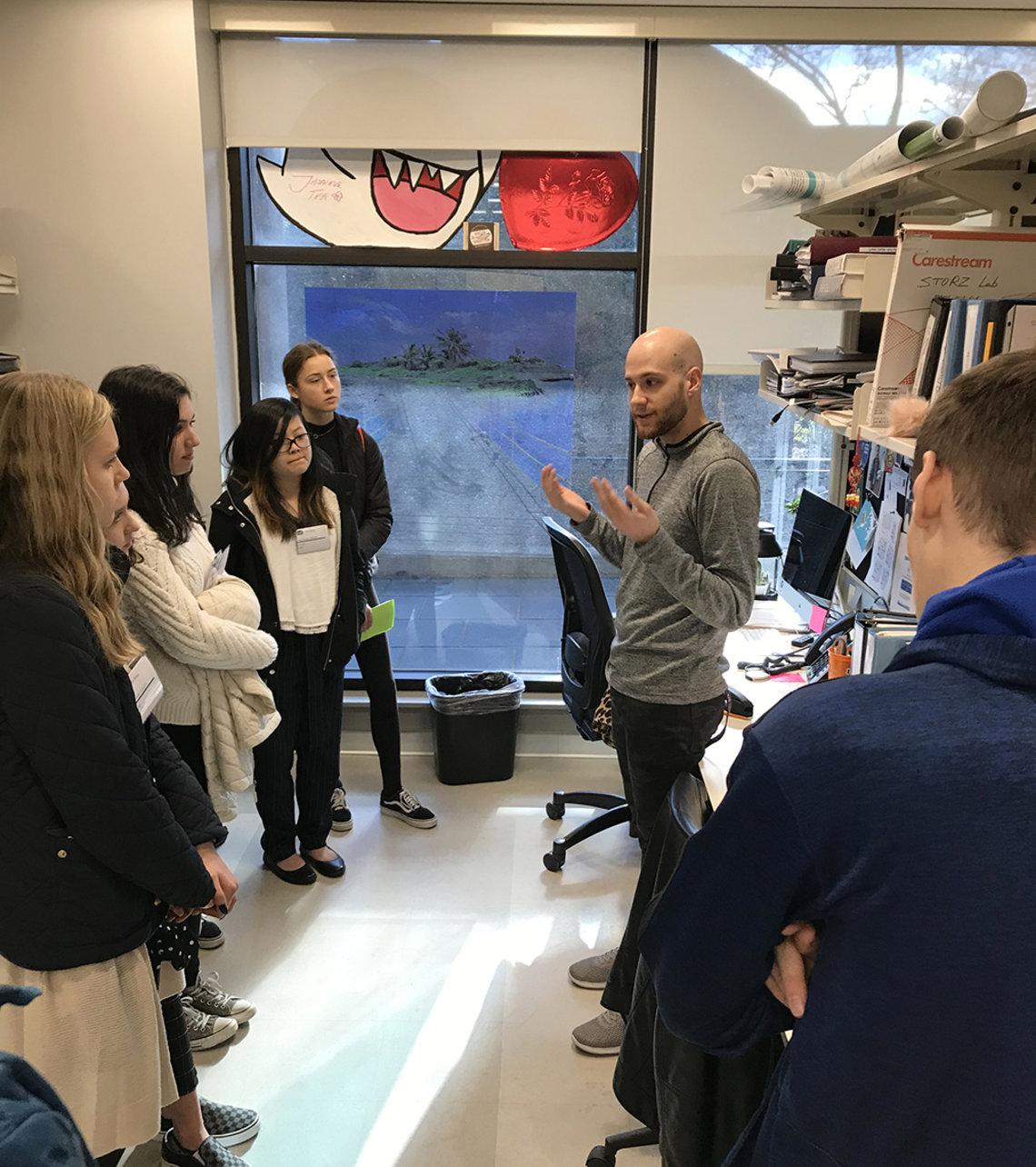 Scientist talks to high schoolers.