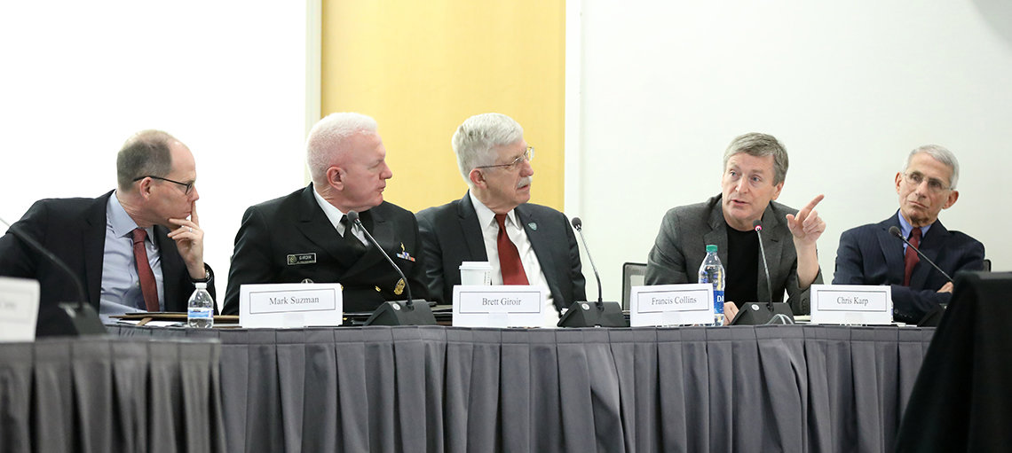 Five men sit on panel