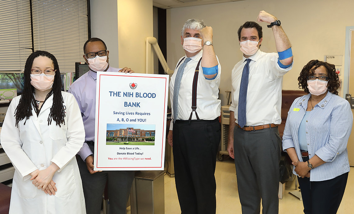 Hargan and his chief of staff stand strong for blood donation.