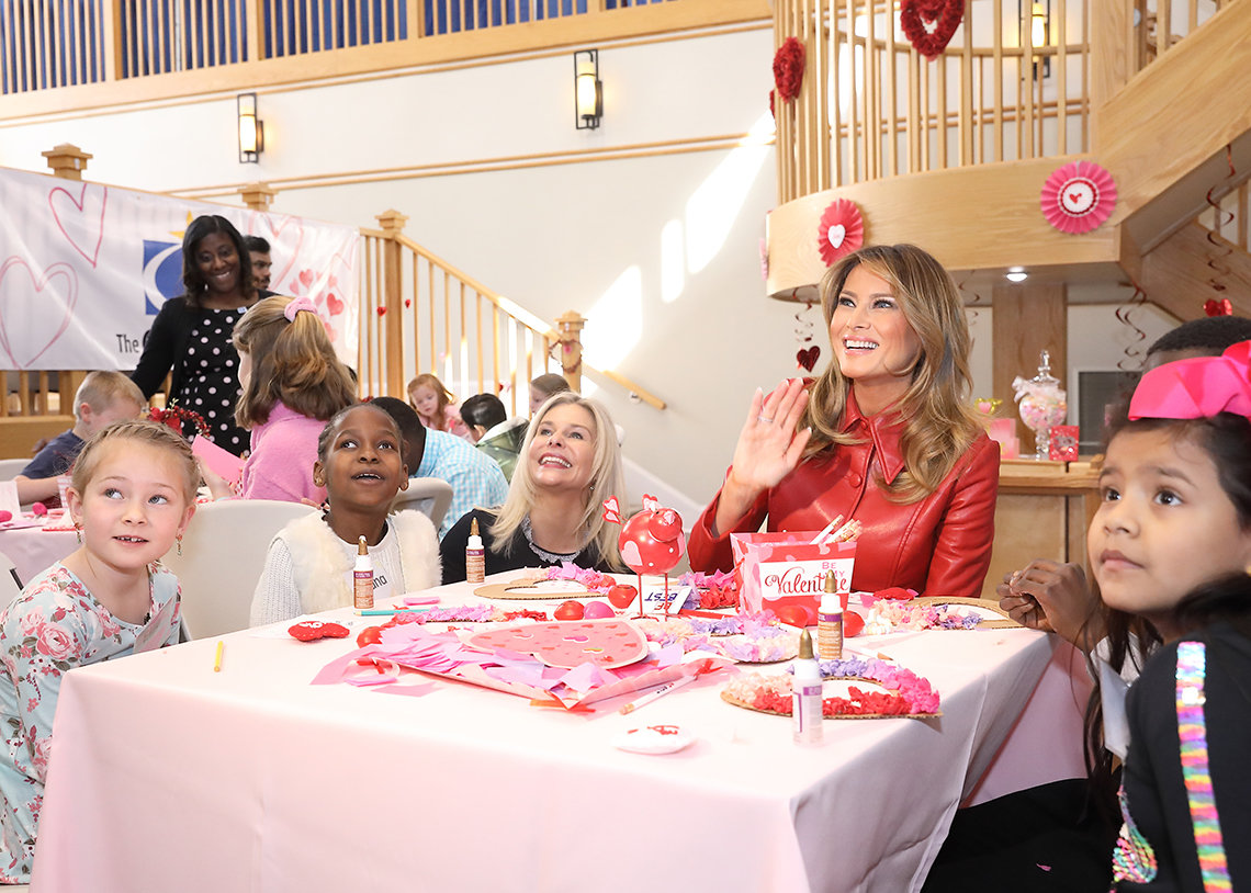First lady waves from table with kids