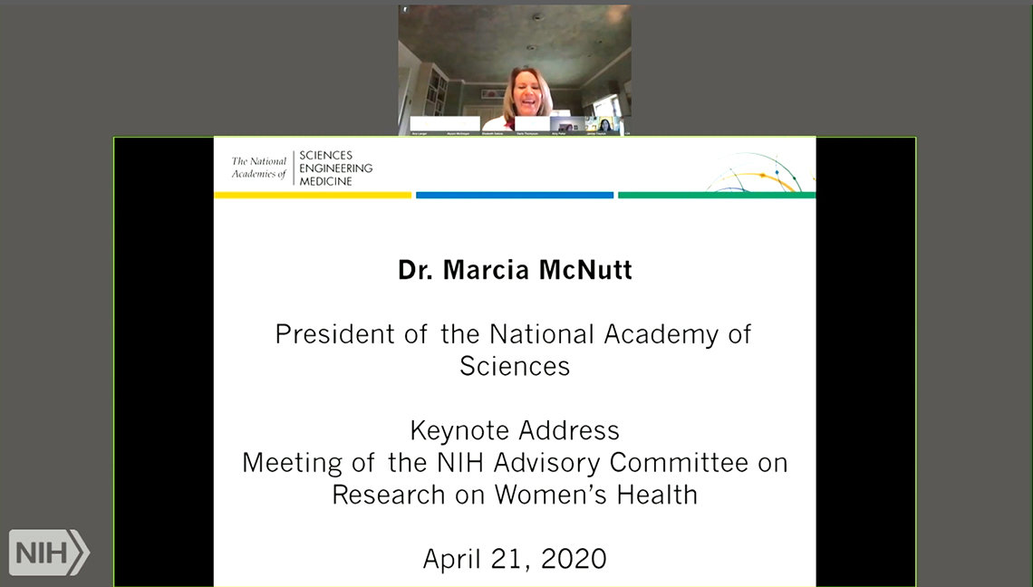 A smiling Dr. McNutt appears over her name and title on a screen monitor, taken from the virtual seminar