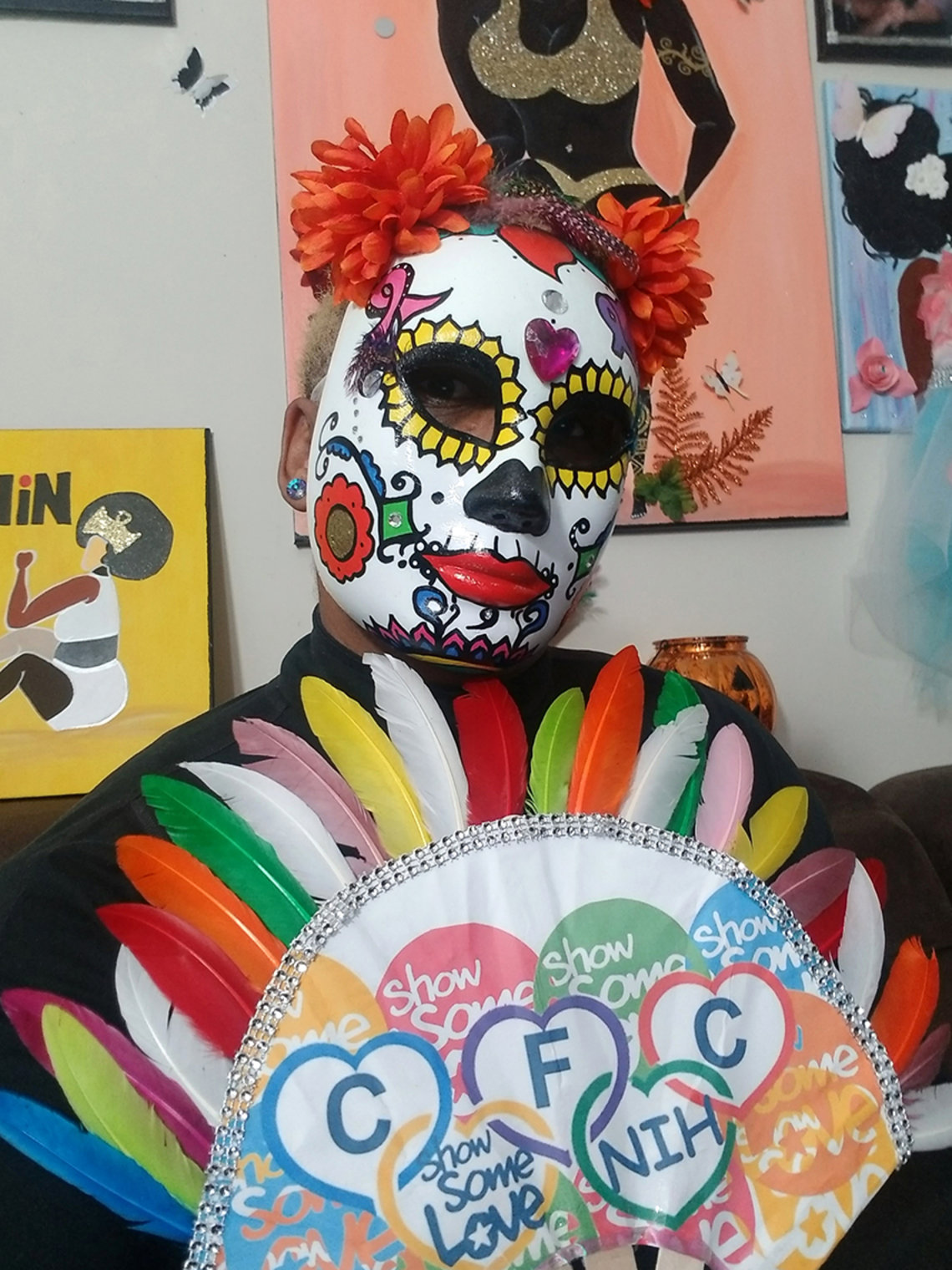 Colorful costume with paper feathers and CFC theme on breastplate