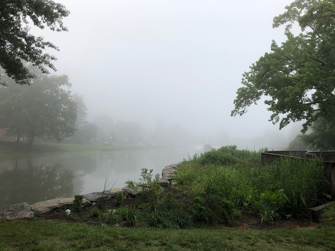 Fog hovers over the lake at Baker Park in Frederick, Maryland.