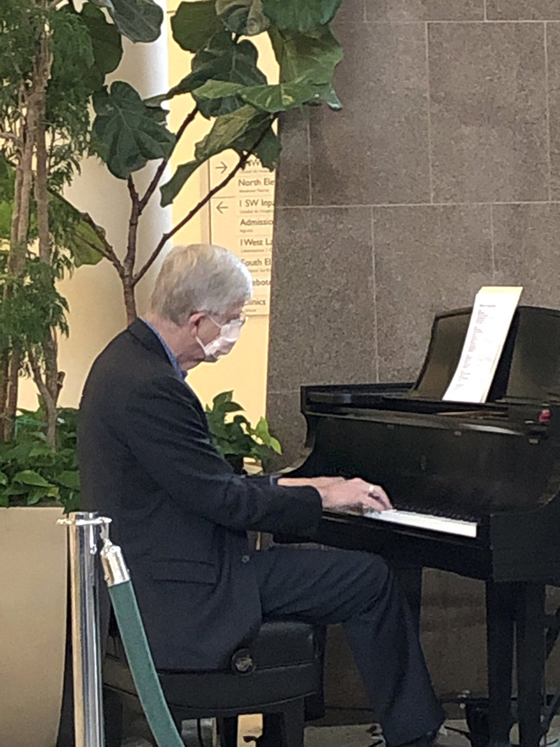 Dr. Collins plays piano.