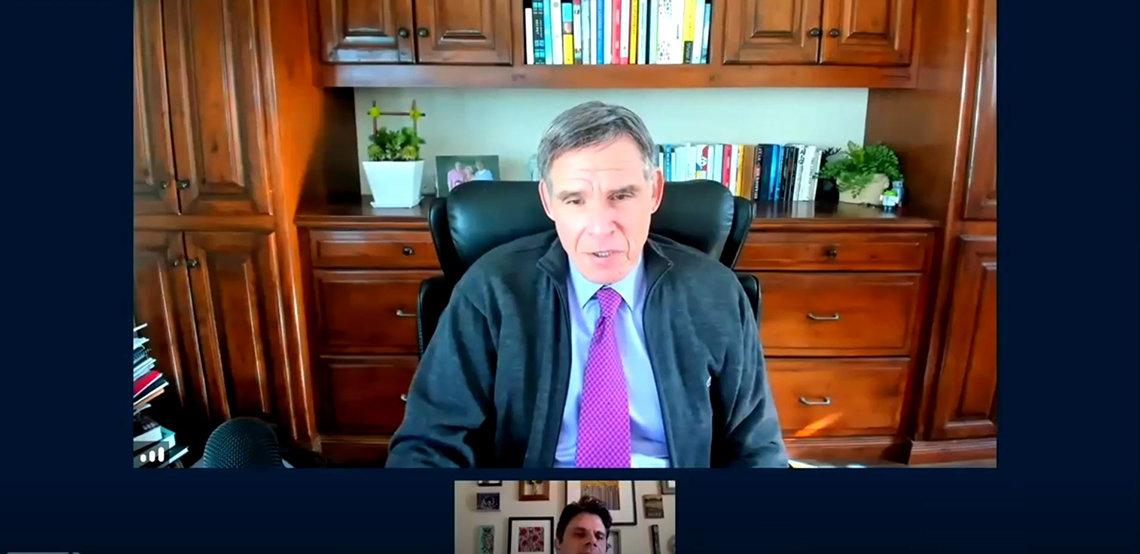 Topol speaks in his office