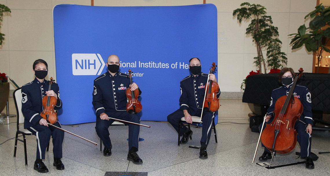 String quartet is seated at atrium.