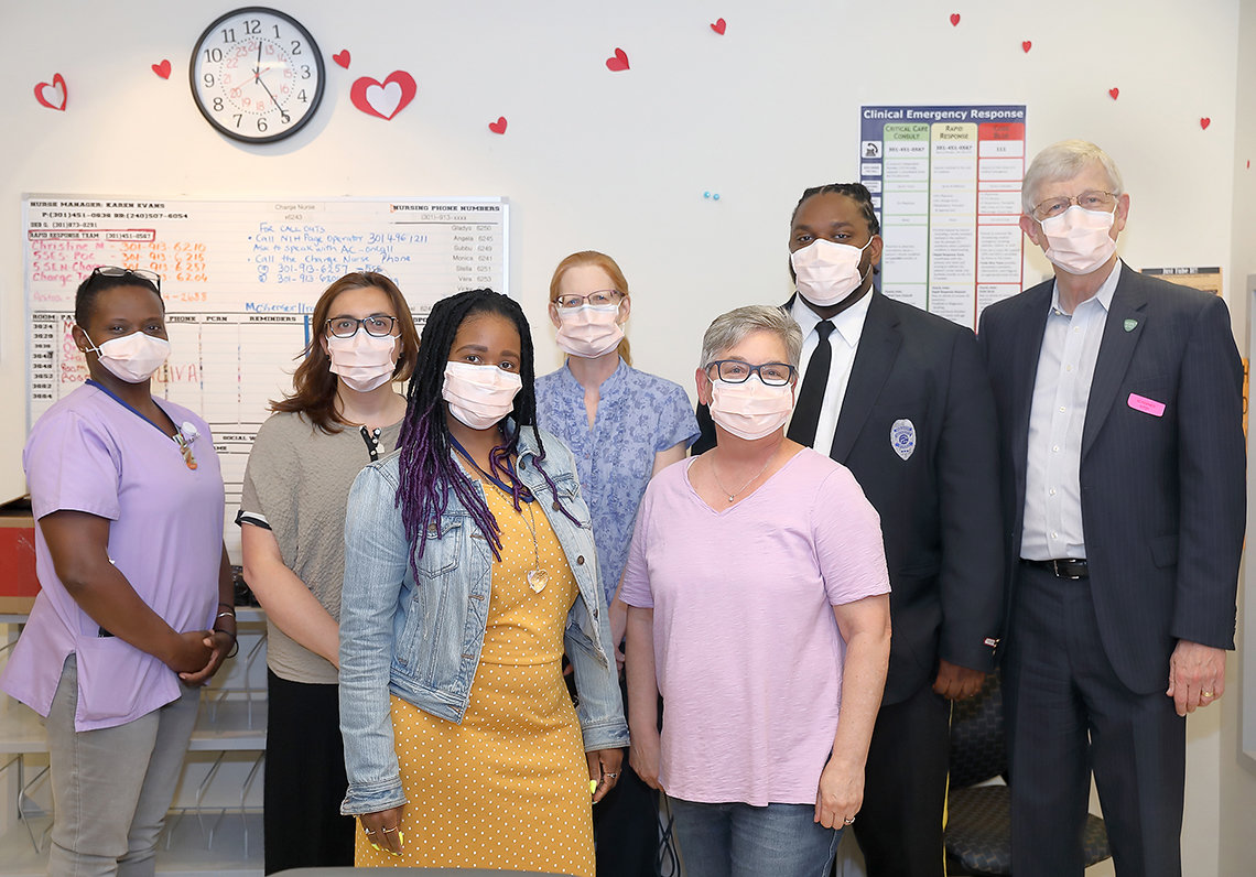 Collins poses with a group of staff members in the Clinical Center.