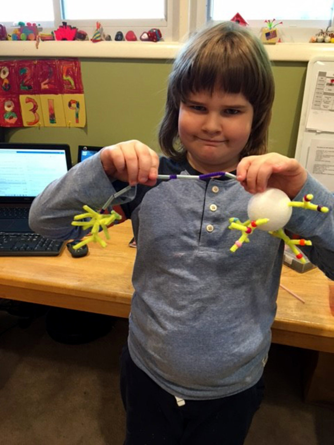 Brown holds up a model of a neuron