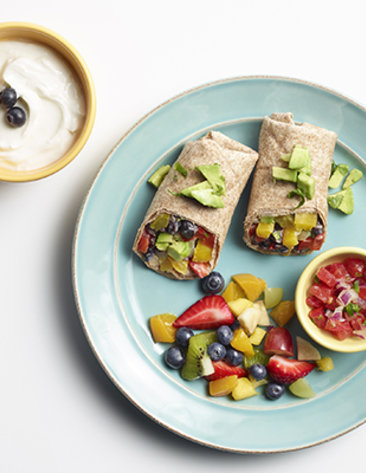Two veggie wraps and fresh fruit