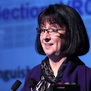 Dr. Nancy Sullivan talks from podium.