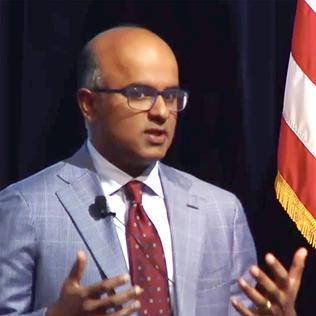 Dr. Sekar Kathiresan at podium