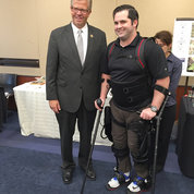 Rep. Randy Hultgren (R-IL) with Reese, a former Navy senior chief petty officer. Although paralyzed from the waist down, Reese can stand and walk with the help of a co-robotic exoskeleton. PHOTO: JOE BALINTFY, SAARAA FAROOQ