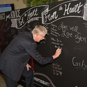 Dr. Collins writes message on blackboard.