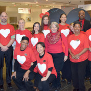 The Bldg. 31 cafeteria staff adds their hearts to the spirit of the day, joining ORS director Dr. Alfred Johnson (third from r) for a photo op.
