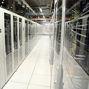 Room of glass-enclosed servers