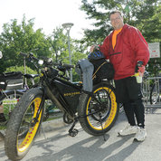 Dominic Napoli, senior IT asset manager at NLM, shows off his Sondors Ebike. The bike has a 350-watt rear hub motor. Top speed is about 22 mph. PHOTO: BILL BRANSON