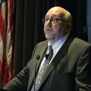 Dr. Steven Clinton speaks at podium