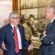 """NINDS director Dr. Walter Koroshetz talks with Moran in front of NIH's exhibit on """"father of neuroscience"""" Santiago Ramon y Cajal.  PHOTO: CHIA-CHI CHARLIE CHANG"""