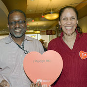 Gibbons and Johnson hold up giant red heart