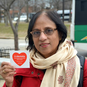 A visitor at the Medical Center Metro station proudly shows off her Wear Red Day sticker. PHOTO: MARK SAMPSON