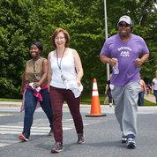 Participants walk the 3.25 mile loop around campus. PHOTOS: JEFF ELKINS, LISA HELFERT