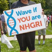 An NHGRI staffer holds up a sign. PHOTOS: JEFF ELKINS, LISA HELFERT