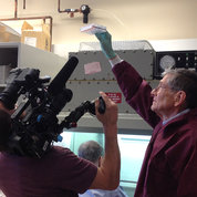 NCI's Dr. John Wunderlich shows a patient's cells to the camera. PHOTO: DONOVAN KUEHN