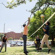 NIH'ers take a break from work to get outside and enjoy a friendly volleyball game. PHOTO: CHIA-CHI CHARLIE CHANG