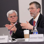 Dr. Michael Lauer (r), NIH deputy director for extramural research, said a paper in PNAS concurred with NIH's own estimate of the cost of redistributing resources to help early and mid-career scientists. Shown at left is Dr. Michael Gottesman, NIH deputy director for intramural research.  PHOTO: ERNIE BRANSON