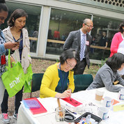APAO members write out names in Chinese calligraphy (Hui Chen) and teach Japanese origami folding (Shioko Kimura).  PHOTOS: KATIE CHAN