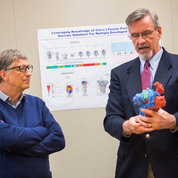 Vaccine Research Center deputy director Dr. Barney Graham (r) shows Gates a molecule model produced using NIH's 3-D print technology.  PHOTO: LISA HELFERT
