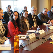 Collins and NIH principal deputy director Dr. Lawrence Tabak join a number of research fellows, postdocs and other trainees who gave firsthand accounts of their NIH experiences.  PHOTO: ERNIE BRANSON