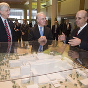 At the Clinical Center model, CC CEO Dr. James Gilman (r) provides the new HHS secretary (c) with an overview of the research hospital complex as Collins looks on. PHOTO: CHRIS SMITH