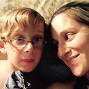 Carly Israel-Agin smiles at her young son Desi