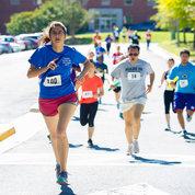 Runners labor along the new course. PHOTO: MARLEEN VAN DEN NESTE