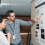 NICHD's Dr. Alejandro Alvarez-Prats discusses his research during one of four poster sessions at the 2017 NIH Research Festival. PHOTO: MARLEEN VAN DEN NESTE