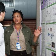NIAID's Dr. Cheri Lee discusses her poster on the FAES Terrace. PHOTO: MARLEEN VAN DEN NESTE