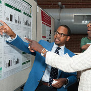 Dr. Dennis Jones of Massachusetts General Hospital, a participant in this year's Future Research Leaders Conference, describes his poster to Dr. Hannah Valantine, NIH chief officer for scientific workforce diversity, whose office sponsors the conference annually. PHOTO: MARLEEN VAN DEN NESTE