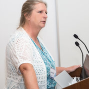 NCI's Dr. Jennifer Couch speaks at symposium. PHOTO: CHIA-CHI CHARLIE CHANG