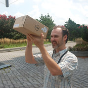 Mike Krzywanos of NLM tries out his homemade cardboard eclipse viewer, which he crafted earlier in the day. PHOTOS: MARLEEN VAN DEN NESTE, RICH MCMANUS, CARLA GARNETT, DANA TALESNIK, CHILDREN'S INN
