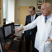 NCI Surgery Branch chief Dr. Steven Rosenberg discusses his research with Azar. PHOTO: ERNIE BRANSON
