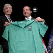 "As a parting gift, Collins presents the Secretary with a set of scrubs. ""Just what the world needs,"" quipped Azar with a laugh, ""a lawyer in the OR!"" PHOTO: ERNIE BRANSON"