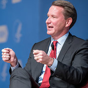 Dr. Sharpless gestures with his hands as he speaks to the audience.