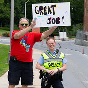 ORS's Joe Cox and Cpl. Christine Fedorisko form cheering squad at hike.