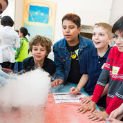 NCI postbaccalaureate Genesis Rivera-Marquez demonstrates the properties of dry ice. PHOTO: CHIA-CHI CHARLIE CHANG